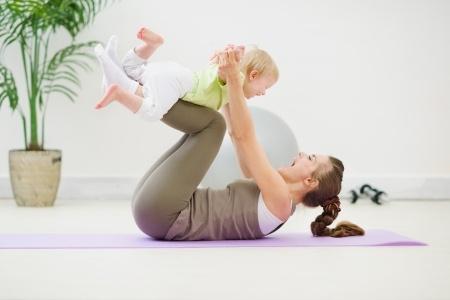 Mum and baby palying on the floor.jpg