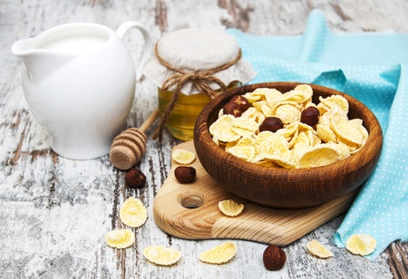 Breakfast spread with muesli and milk jug.jpg