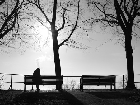 person sat on a bench in the winter.jpg