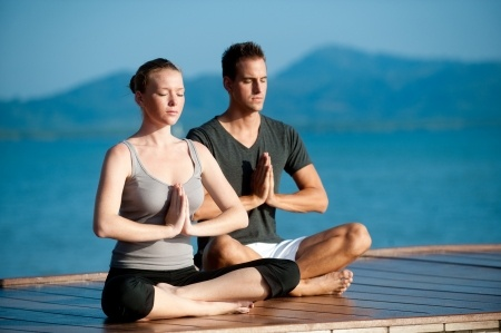 Man and woman doing yoga.jpg