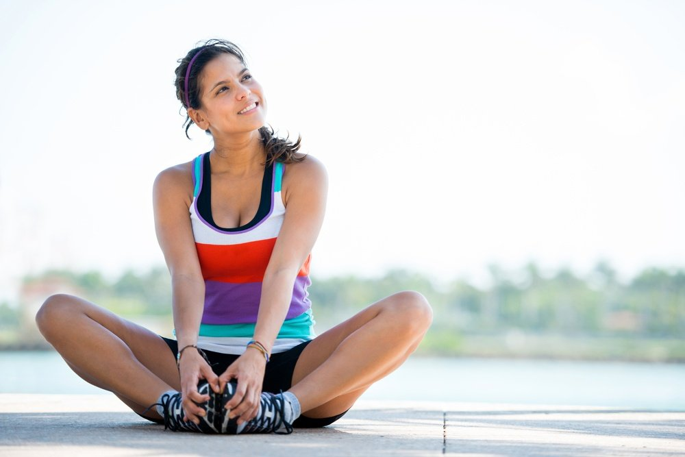 Beautiful thoughtful woman working out outdoors and smiling.jpeg
