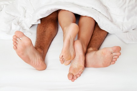 Couples-feet-at-end-of-bed.jpg