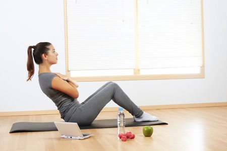 Girl-doing-exercise-at-home-with-computer.jpg