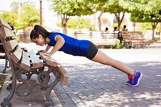 Girl-doing-press-up-on-benh.jpg
