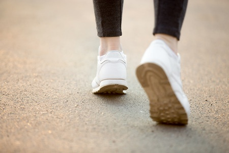 Pair-of-white-trainers-taking-steps.jpg