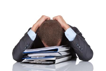 Frustrated man sat at deskjpg