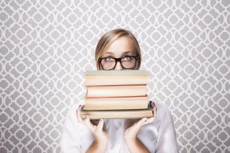 girl-peering-over-stack-of-books.jpg